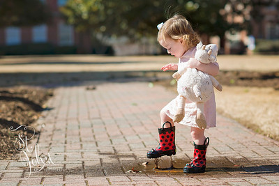 Shoes... Madeline found a mud puddle to jump in today. I am so glad that I had her rain boots on her.