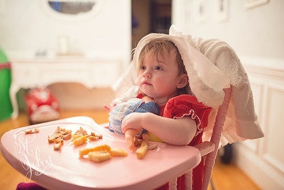 "Nutty. Miss Madeline HAD to HAVE her ""the Baby"" & her blankie while she ate her dinner. She decided that her blankie HAD to be on her head for her to eat. I have a crazy baby!"