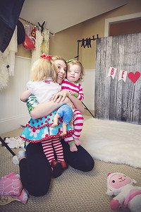Behind the Lens & Snuggle... a 2 for 1. This us TRYING to take Valentine photos. Madeline &Felicity were not on the same page. Boo. But at least Ashley got some sweet baby love.