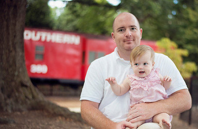Outside. We went to Pullen Park on Maddie's 1st birthday. I STILL haven't edited those photos. I am a slack Momma.