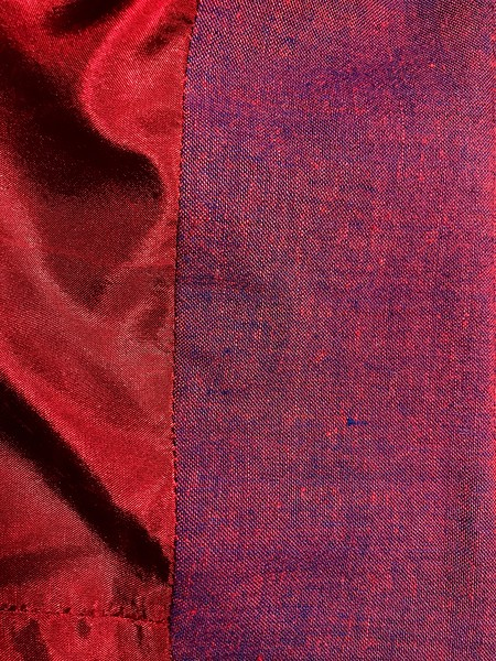 I had a perfectly matching navy lining stowed away with this fabric, but when I pulled it out of my stash, I noticed it felt wrong. A burn test confirmed it was a yucky synthetic. Ester's on the island didn't have any navy silk or rayon, so I got this red silk, which matched perfectly. <br /> <br /> But I didn't love it. It didn't look right until I attached it to the waistband facing.