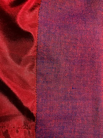 I had a perfectly matching navy lining stowed away with this fabric, but when I pulled it out of my stash, I noticed it felt wrong. A burn test confirmed it was a yucky synthetic. Esther's on the island didn't have any navy silk or rayon, so I got this red silk, which matched perfectly. <br /> <br /> But I didn't love it. It didn't look right until I attached it to the waistband facing.