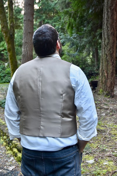 I also appreciated the lack of a belt in the back. (If you don't know what I'm talking about, look at the back of a ready-to-wear vest.) That was the first change I made to his McCall's vest pattern.