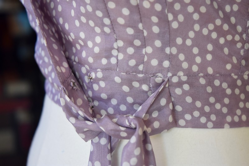 I hand sewed snaps in place of the hooks and eyes on the waist tie. You can also see the trio of darts here. It was annoying to sew so many darts, but it definitely eliminates any pointy boob consequences of a single dart. This could be a useful design element on a project with less drape.