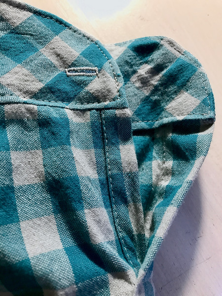In all the chaos of moving, I made one pretty good mistake. I sewed the buttonhole to the underside part of the left cuff. And I didn't notice it until AFTER I cut the freakin' thing open. I'm usually really careful about these things. I guess I was so concerned with lining up the plaid, I spaced it.