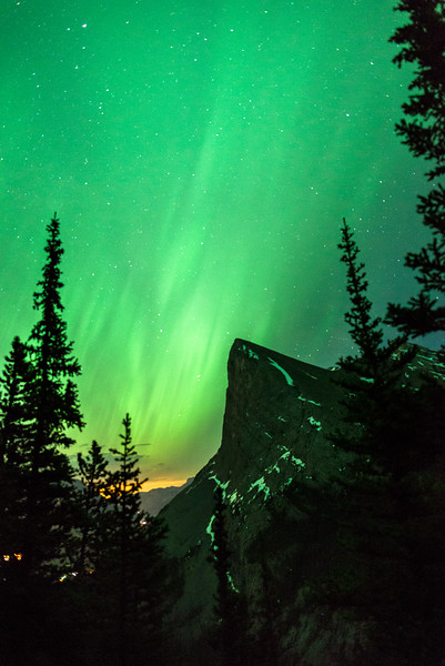 A rare view of the popular Ha Ling Peak as the Aurora shines bright above.