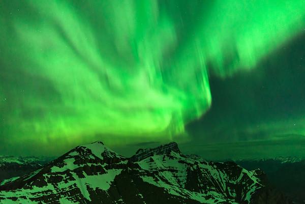 Aurora dances over Mt. Rundle.