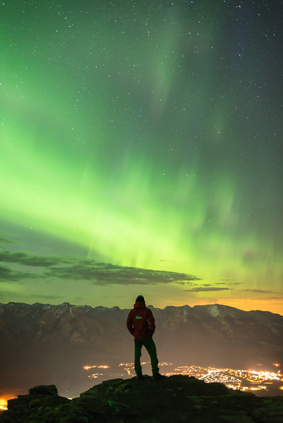 Taking in the view over Canmore as the Northern Lights continued to dance across the sky.