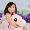 Unicorn backdrop and stuffed animal available