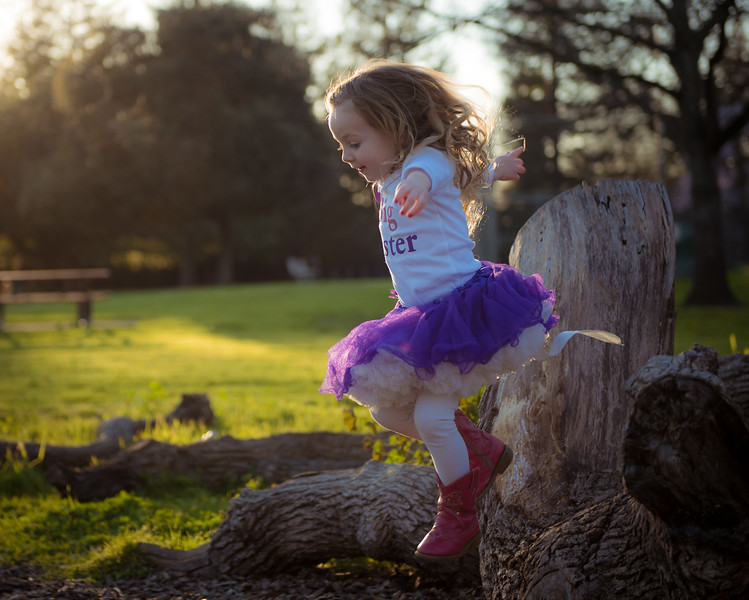 Family Photography of Zoey Grace in a field of flowers.
