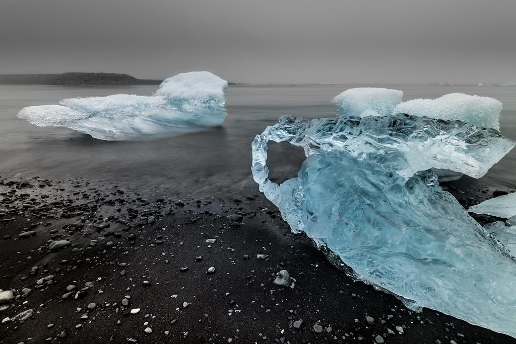 Small Icebergs on the ocean beach near Jokulsarlon glacial lagoon in Iceland