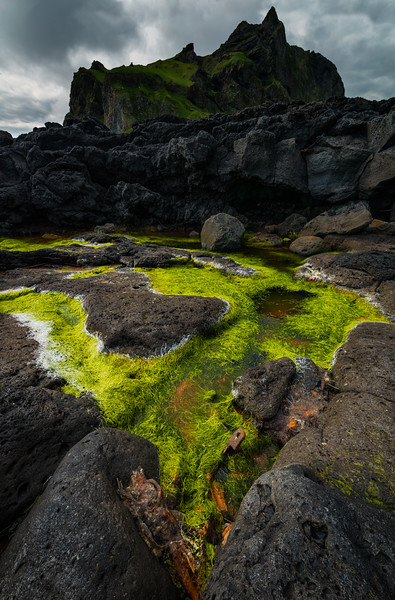 Tidal pool and anchor on Heimaey island, Iceland
