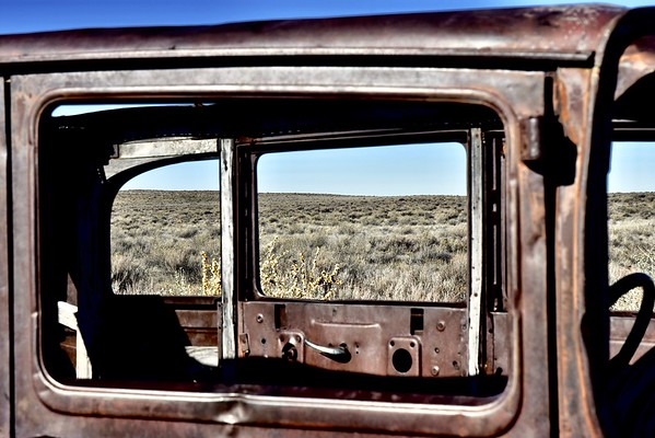 A gutted 1932 Studebaker marks where Route 66 used to cut through the park.