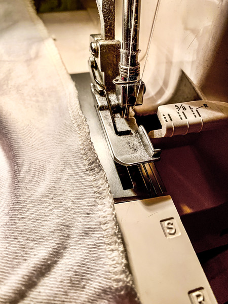 As a bonus, I got to use my new-to-me overlocker. A patient moved out of the country and sold me her serger with all her thread cones. I used it to shorten the sock-like knit cover that came with the mattress.
