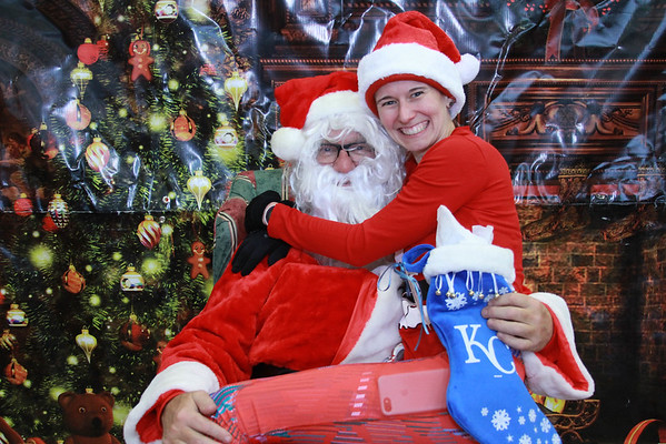 At the Great Santa Run this past weekend. I was so glad I got to squeeze in one last KCRC race before I leave. Also, I don't usually sit on Brad's lap/Photos by Gerry (I think) and courtesy of KC Running Company.