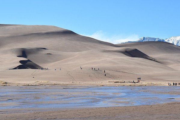 I was glad we didn't wait until the sun came out to check out the dunes. This large school group (only about a third to half are in this photo) made its way across Medano Creek as we headed back to camp.