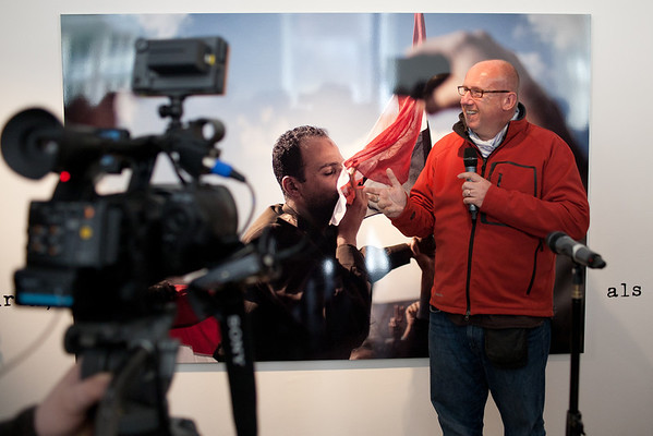 This is AFP Photographer Marco Longari, during the opening of an exhibition of his images taken in Cairo Tahrir Square 2011. He did remarkable and outstanding images on this, which I like to point out. You may search the web for more.