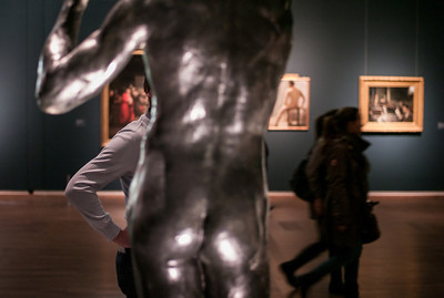"""Bronze sculpture by Auguste Rodin, Title """"The Age of Bronze"""" 1877  Exhibition 'nude men' at Leopold Museum, Vienna."""