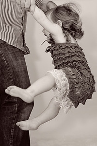 This is how Daddy kept Madeline happy during the photo shoot