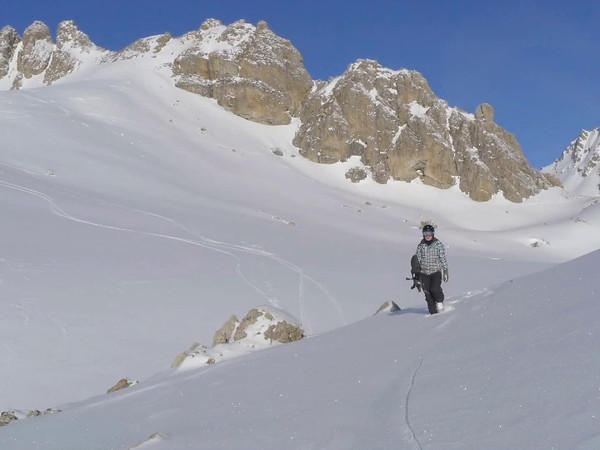 "Good start of the new week with Cécile. On our snowboards to Piz Padella. Near perfect snow conditions on the 1200 vertical meters. Music: ""Patriot"" by M.W.Smith"