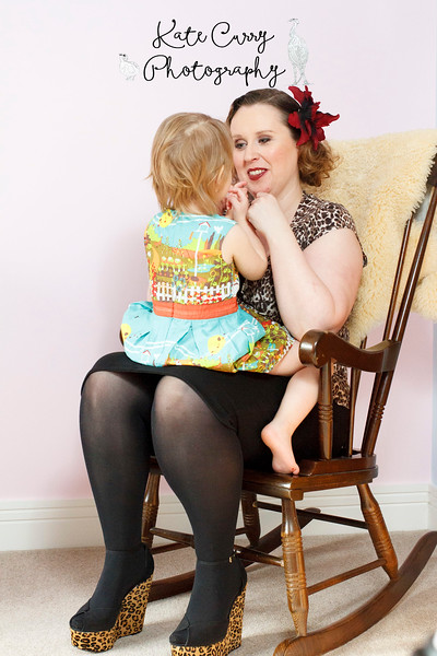 Vintage styled mum and her young daughter in a rocking chair, Lenzie
