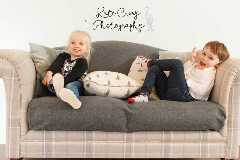 Children posing on a sofa