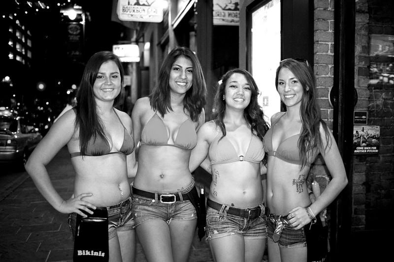 Bikinis Employees pose for the film camera - Austin, Texas