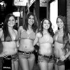 Bikinis Employees pose for the film camera - Austin, Texas
