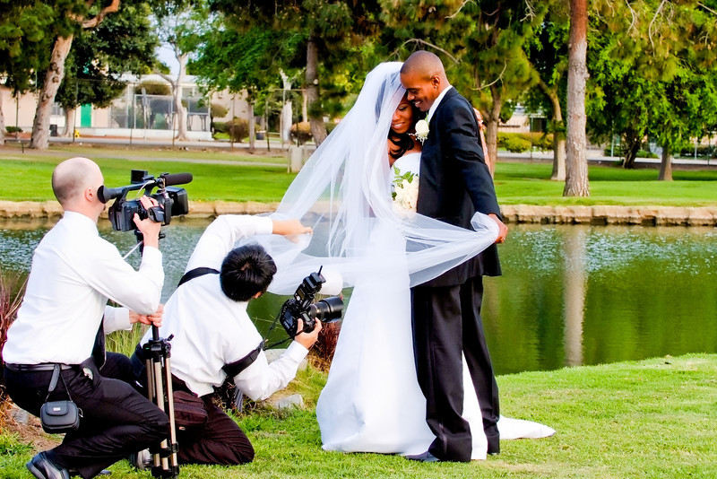 Wedding videography and photographer working together to get the shot