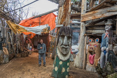 Nick admiring Rolfs handywork  at the Radium Woodcarver Home. House of 1000 faces. This place is so cool and a different kind of attraction.  Unfortunately it burned down in 2018