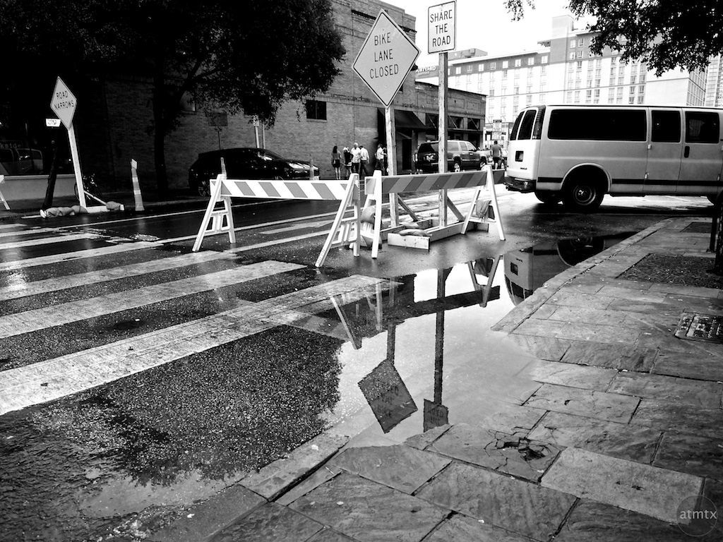 Puddle and Reflection, 6th Street - Austin, Texas