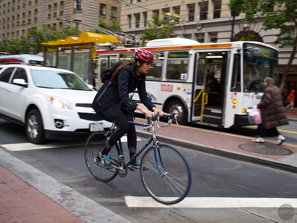 Bicycle Commuter, Market Street - San Francisco, California