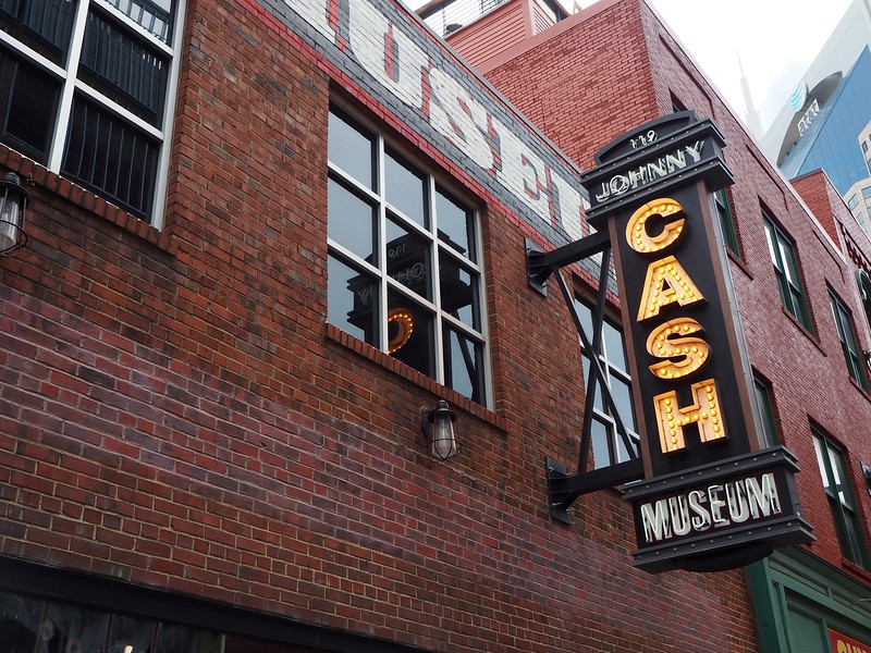 Neon sign indicates the Johnny Cash Museum entrance