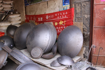 giant woks in Xi Zhou Village, Yunnan Province, China by Karen B.