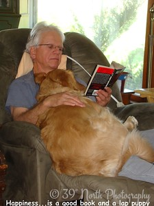 Happines...is a good book and a lap puppy by Sandi P.