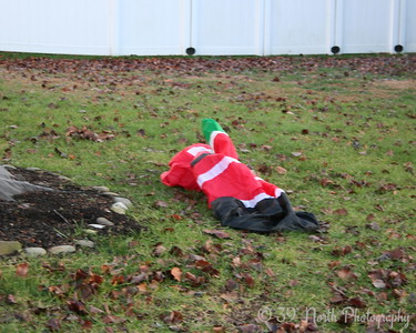 Santa's Deflated Because You Don't Believe. by Carol Anne P.
