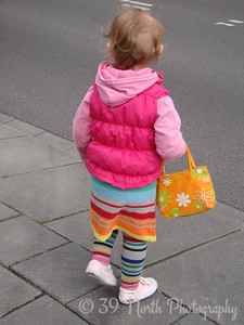 TWO year old with smashing orange purse about to cross the line! by Annet H.