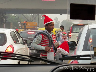 New Delhi street vendor selling Santa hats by Dave T.