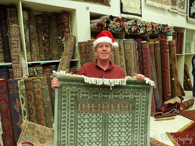 Helping pick out carpets for Santa  by Dave T.