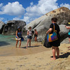 Beach, people and boulders.