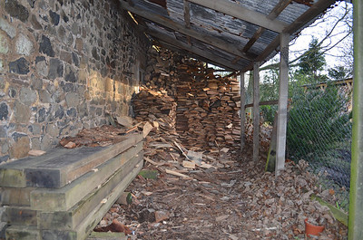 This was the old hen house which we originally kept chickens in. It wasn't fox proof and the poor chickens met an untimely end. Latterly we've used it as a log store. It's on it's last legs, so I'm going to remove it to reveal the wall and widen the space between it and the big log store opposite. I will get a JCB in to remove the wind blown loam which makes the roadway a swamp when its wet and cover the whole area in some quarry chips.