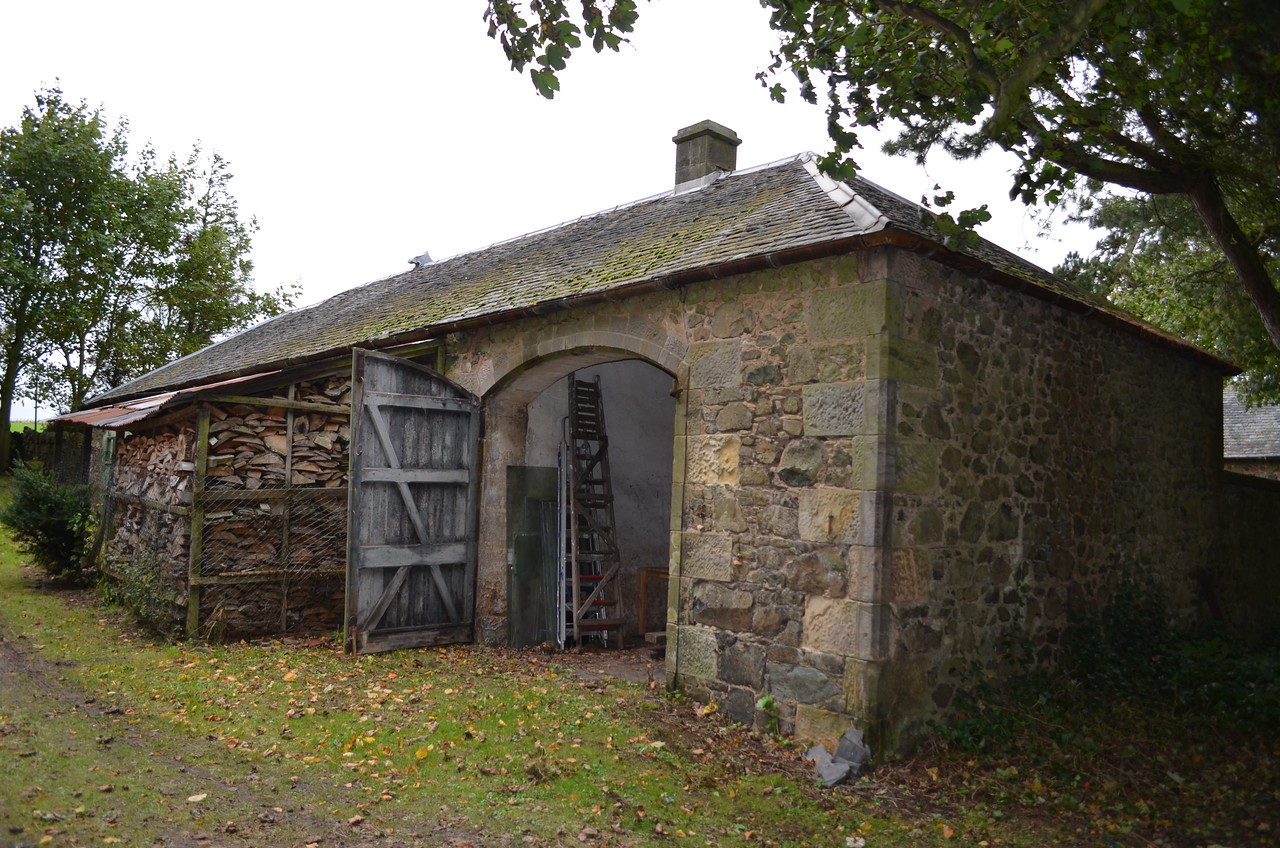 This is the south facing barn. Once the woodshed to the left is empty, I will remove the structure to allow more natural light into the gallery space