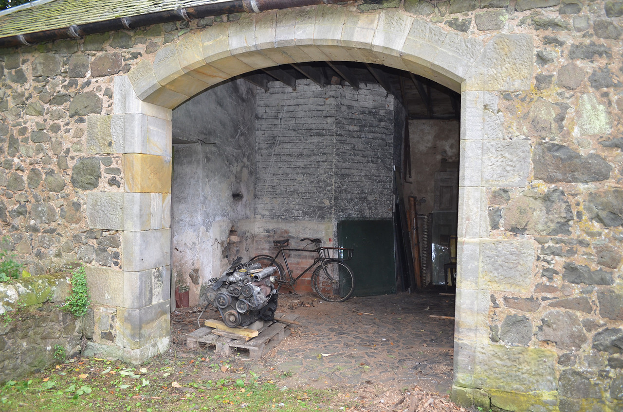 This doorway opens into the stable yard.