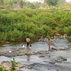 Local children play in the river