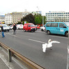 This swan got loose on the Mont Blanc bridge. Traffic was backed up for 20 min while they tried to get him off the road.