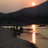 Local villagers bathe in the Mekong at sunset
