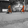 The monks leave their monasteries every morning at 6:15 to collect their food for the day.