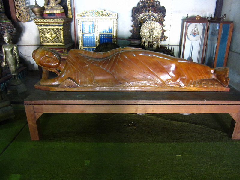A wooden reclining Buddha. The only one I saw that wasn't covered in gold.