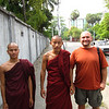 These monks stopped us on the street because they wanted to chat.