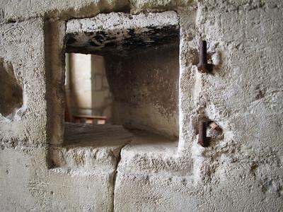 Hole in cell wall for prisoners to view holy service, Chartreuse du Val de Benediction, Villeneuve-les-Avignon